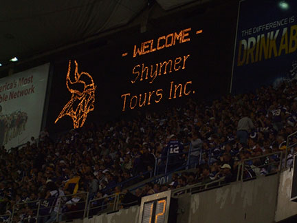 Shymer Tours up on the Metrodome Scoreboard